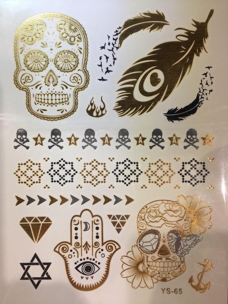 gold tattoo page, skull & bones